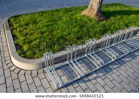 new bicycle racks made of metal Royalty-Free Stock Photo #1848641521