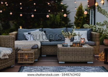 Summer evening on the patio of beautiful suburban house with garden Royalty-Free Stock Photo #1848763402