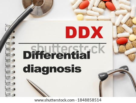 Page in notebook with DDX Differential diagnosis on white background with stethoscope and group of pill. Medical concept. Term and abbreviation Royalty-Free Stock Photo #1848858514