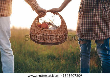 Closeup of picnic basket. Couple in love. Love story.