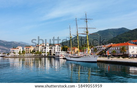 "Sailing yacht at the Pina embankment. Embankment and port ""Porto Montenegro"". Lustica Bay is a mini city with a yacht  . Buildings on the embankment of the city of Tivat. Montenegro.  Royalty-Free Stock Photo #1849055959"