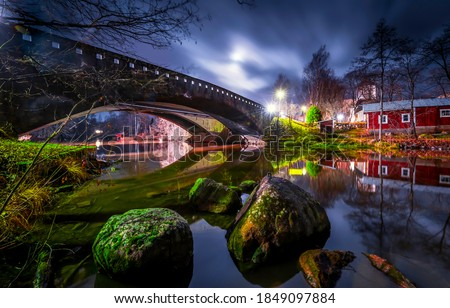 River bridge in night city. Bridge over river. River bridge night scene #1849097884
