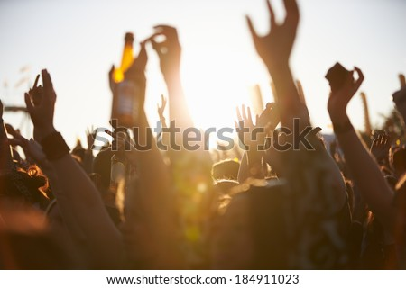 Crowds Enjoying Themselves At Outdoor Music Festival Royalty-Free Stock Photo #184911023