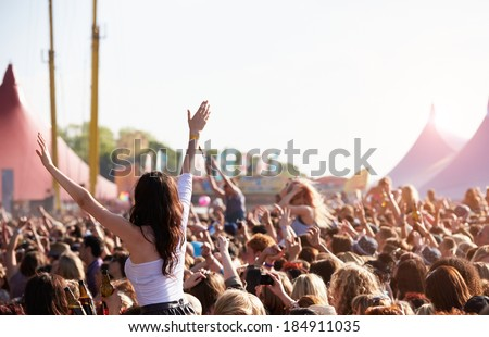 Crowds Enjoying Themselves At Outdoor Music Festival Royalty-Free Stock Photo #184911035