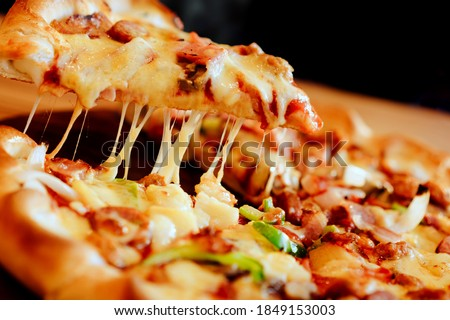 A picture of beautiful view of pizza, meats chicken cheese vegetarian,blurred background