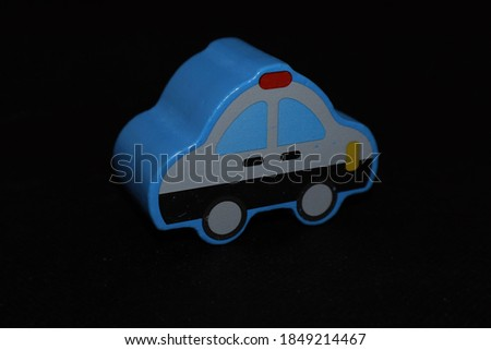Police car shaped toy wooden stick