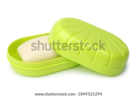 Green plastic soap dish with soap on white background Royalty-Free Stock Photo #1849321294