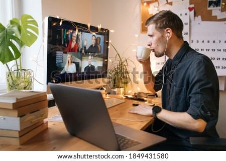 Morning coffee break during work from home. Man working on computer in office. Video conference remote call. Business internet telework. Businessman drinking coffee by laptop. Lunch break #1849431580