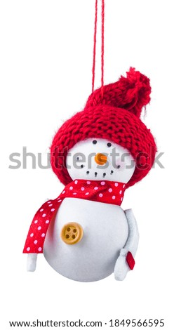 Christmas snowman in a knitted red hat on an isolated white background