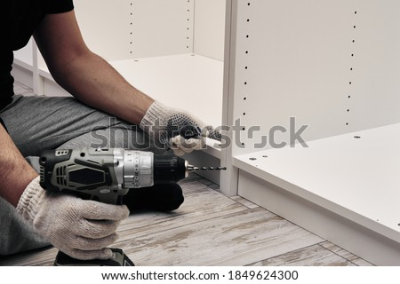 Furniture assembly process. Assembling several pieces of furniture. Do it yourself Royalty-Free Stock Photo #1849624300