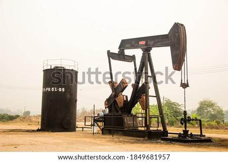 Oil drilling derricks at oilfield,An oil well pump jack pumping ,industrial equipment.