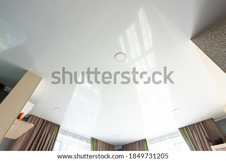 Classic white glossy ceiling with recessed spotlights Royalty-Free Stock Photo #1849731205