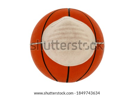 Basketball ball wearing face mask. Concept for Coronavirus COVID 19 pandemic and epidemic affecting basketball seasons game suspend. Isolated on white background.