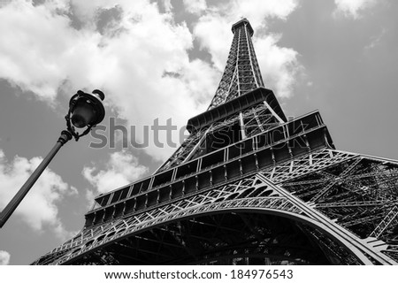 Eiffel tower and parisian streetlight. Black and white.