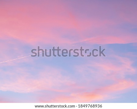 Soft, fluffy and colorful cloud formation. Abstract idyllic pink and blue sky. Blur background texture of colorful sunset clouds. Twilight sky. Fresh air, weather concept Royalty-Free Stock Photo #1849768936