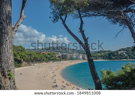 Seascape. Sandy beach of the Mediterranean sea (Lloret de Mar, Spain). Stock photo.