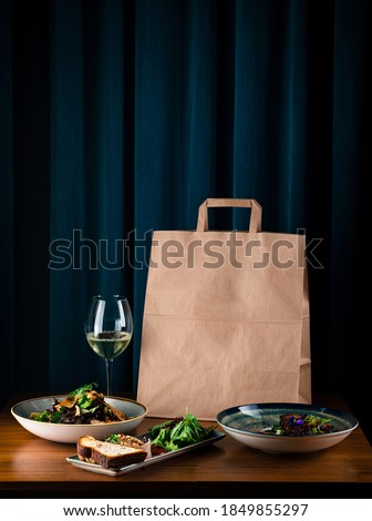 daily meals and snacks. Diet nutrition and brown paper bag package with copy space, Healthy food delivery from a restaurant, delicious food on the background of a paper bag package Royalty-Free Stock Photo #1849855297