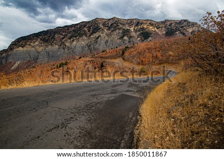 The high granite peaks and cliffs of northern Utah are spectacular in the fall.  The mountain roads provide endless, panoramic views of the rugged area. Royalty-Free Stock Photo #1850011867