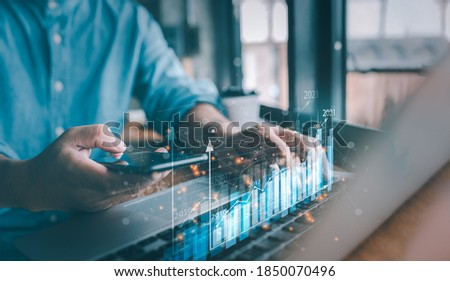 2021 business finance technology and investment concept. Stock Market Investments Funds and Digital Assets. businessman analysing forex trading graph financial data. Business finance background. Royalty-Free Stock Photo #1850070496