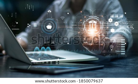 Businessman using laptop and touching icon banking on network connection. Digital marketing. Finance and banking networking. Online shopping and customer network, cyber security. Business technology. Royalty-Free Stock Photo #1850079637