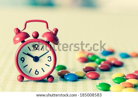 Alarm Clock and candy on the table  instagram photo #185008583