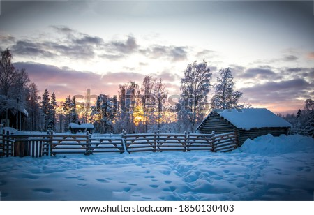 Winter snow village in morning. Snowy winter village at sunrise. Sunrise winter village snow. Winter snow sunrise scene Royalty-Free Stock Photo #1850130403