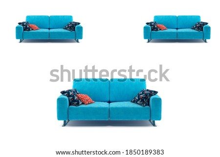 Background of a blue cushions sofa with three pillows. #1850189383