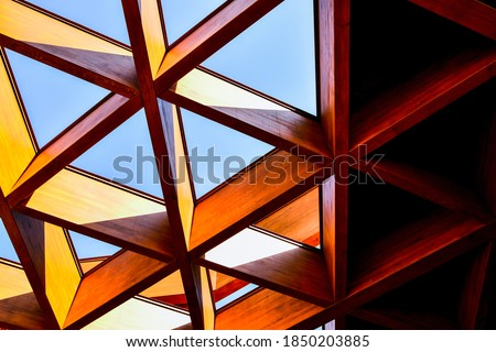 Roofing Construction. Wooden Roof Frame House Construction. Abstract Structure background. Wood texture pattern. Architecture minimal concept. Visual art. Conceptual photography.