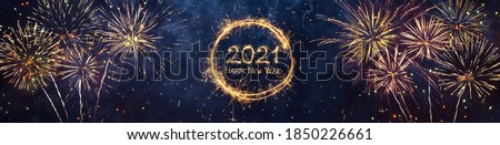 Wide Angle holiday web banner Happy New Year 2021. Beautiful Panoramic header for website or billboard with Golden sparkling text Happy New Year 2021 written sparklers on festive blue background. Royalty-Free Stock Photo #1850226661