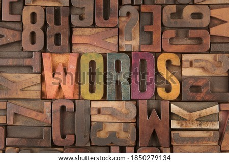 words word in vintage letterpress wooden blocks Royalty-Free Stock Photo #1850279134