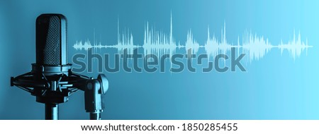 Professional microphone with waveform on blue background banner, Podcast or recording studio background Royalty-Free Stock Photo #1850285455