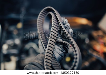 concept of replacing the timing belt in the garage, the gas distribution mechanism. Royalty-Free Stock Photo #1850379160