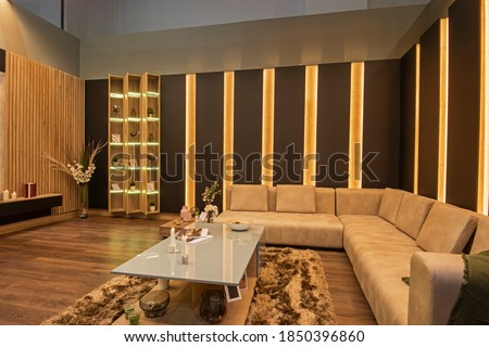 Living room lounge area in luxury apartment show home showing interior design decor furnishing with large sofa Royalty-Free Stock Photo #1850396860