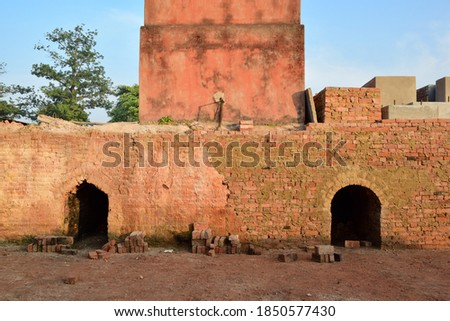 Close-up of empty brick fireplaces at a small red brick factory in rural India. #1850577430