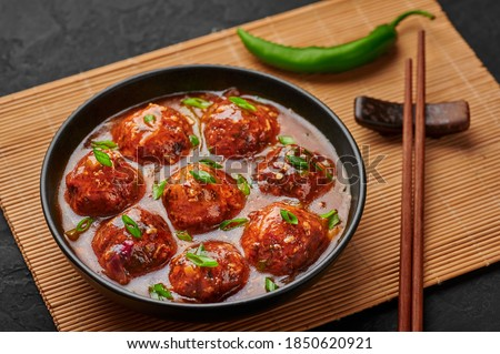 Veg Manchurian Gravy Balls in black bowl in dark slate table top. Vegetarian Manchurian is indian chinese cuisine dish. Asian food and meal Royalty-Free Stock Photo #1850620921