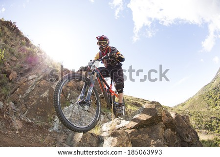 """MALAGA, SPAIN - MARCH 30: Unknown racer on the competition of the mountain bike """"BIG RIDE Open to Spain to Enduro"""" on March 30, 2014 in Malaga, Spain #185063993"""