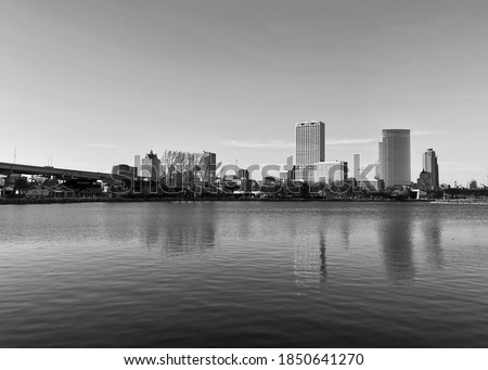 Downtown Milwaukee reflects off the water of Lake Michigan in the winter.