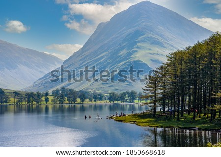 Beautiful lake of Buttermere surrounded by green hill in England's Lake District Royalty-Free Stock Photo #1850668618