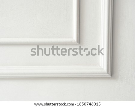 Beautiful ornate white decorative mouldings in studio. Decorative stucco in the classic interior of the house. The angle of the frame molding white for clipart. White cement plaster wall background. Royalty-Free Stock Photo #1850746015