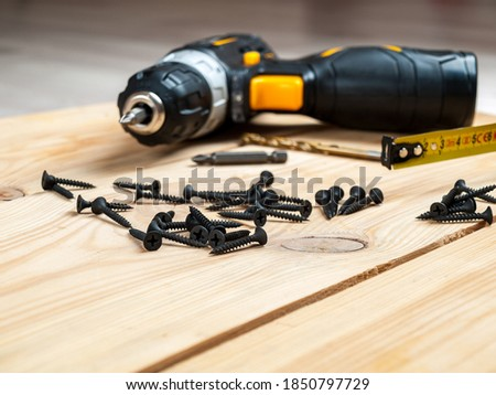 screws self-tapping screws on the background of a screwdriver, a selection of different self-tapping screws for different materials of walls and surfaces Royalty-Free Stock Photo #1850797729