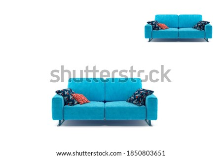 Background of a blue cushions sofa with three pillows. #1850803651