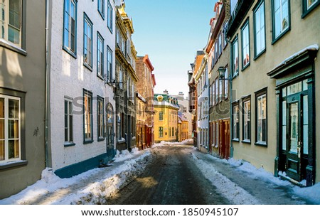Naroow street in winter town. European narrow street in winter. Winter narrow street in town. Narrow street in winter #1850945107