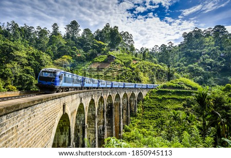 Mountain forest railway bridge train ride. Mountain railway bridge train ride. Railway bridge train ride. Train ride on railway bridge #1850945113