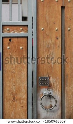 Wooden door with a steel frame And has an ancient digital-like locking device, Tbilisi, Georgia                            #1850968309