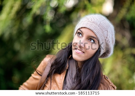 Portrait of gorgeous looking woman outside in nature #185113715