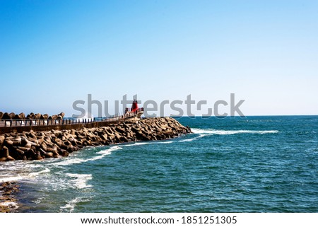 East sea breakwater landscape, with blue sky. Royalty-Free Stock Photo #1851251305