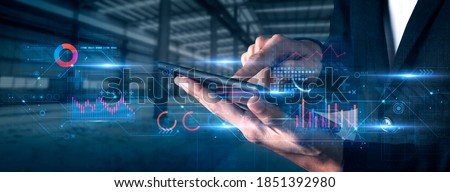 Finance business investment strategy competition, investment security data analytic artificial intelligence technology finger point futuristic graph chart stock exchange data finance symbol screen Royalty-Free Stock Photo #1851392980