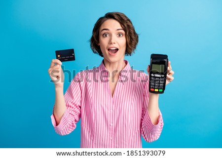 Photo of astonished lady hold pos terminal show credit card wear formal white pink shirt isolated on blue color background Royalty-Free Stock Photo #1851393079