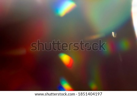 Colourful lens flare and haze on black background. Royalty-Free Stock Photo #1851404197