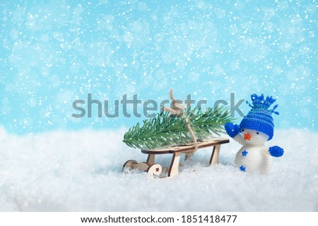 Christmas banner background with snowflakes and snowman delivering xmas tree. New year celebration and winter wide image with copy space for text